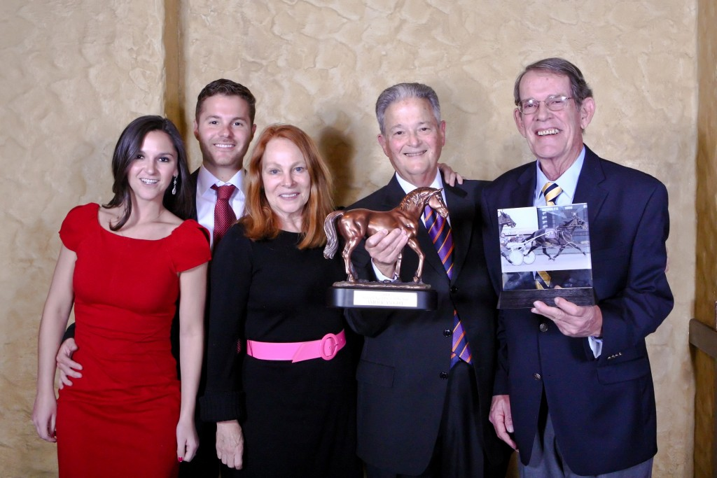 Family accepting the American Girl Aged Pacer of the Year Award